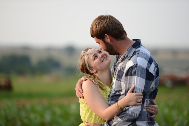 Engagement shoot of couple in field